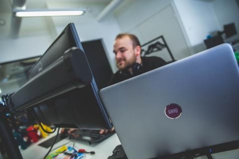 Developer at work on his computer.